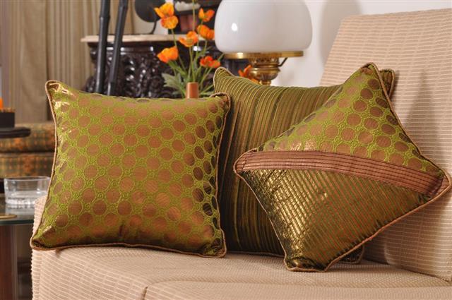 Three sofa cushions