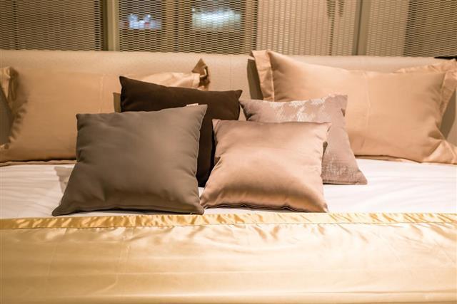 Colorful pillows on gray sofa