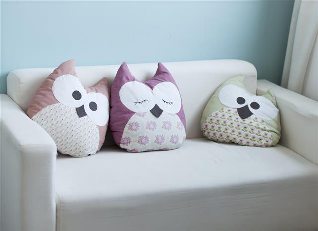 White sofa with cute owl pillows