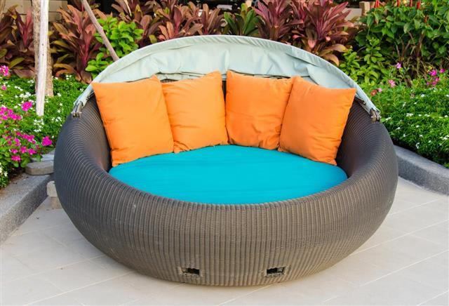 Rattan armchair furniture in garden