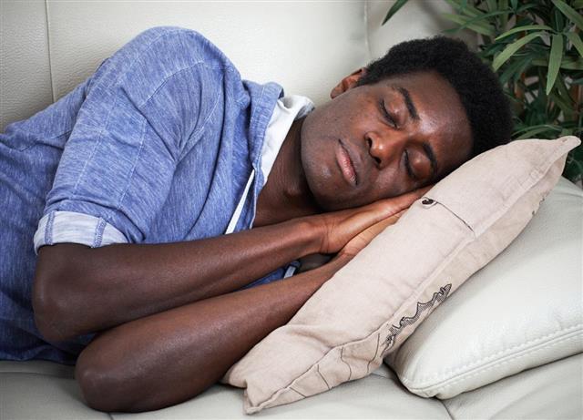 Sleeping Afro American man.