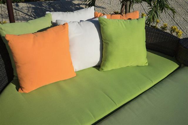 Outdoor pillows on sofa under brilliant sunlight