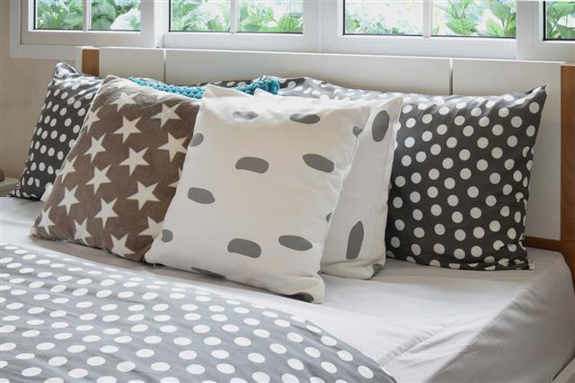 Polka Dot Pillows On Bed