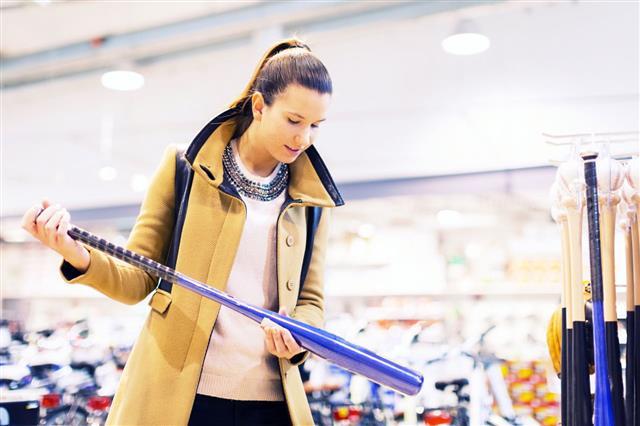 Young Adult Buying Baseball Bat