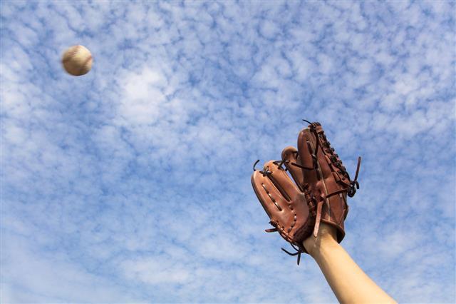 Hand In Baseball Glove