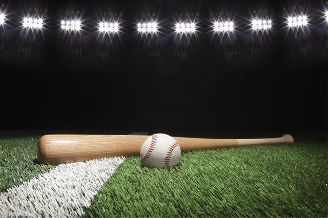 Baseball And Bat Under Lights