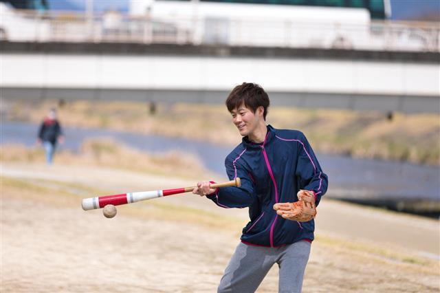 Happy Couple Practicing Baseball