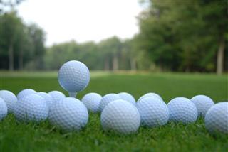 White Golf Balls On Grass