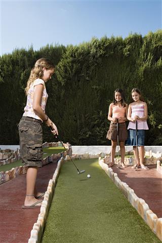 Friends Playing Miniature Golf