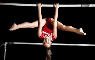 Strong Gymnast Girl Exercising
