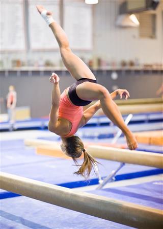 Gymnast Mid Flip On Balance Beam