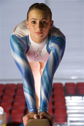 Gymnast Balancing On Balance Beam