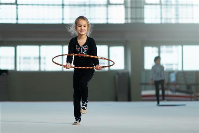 Girl Learning Rhythmic Gymnastics