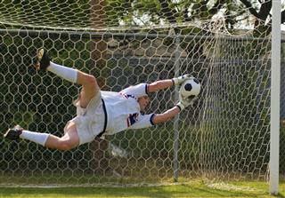 Goalkeeper In Mid Air Saving Ball