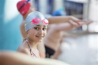 Little Girl In Googles Swim In Pool