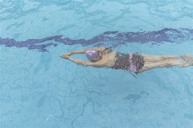 Asian Swimmer In Breaststroke