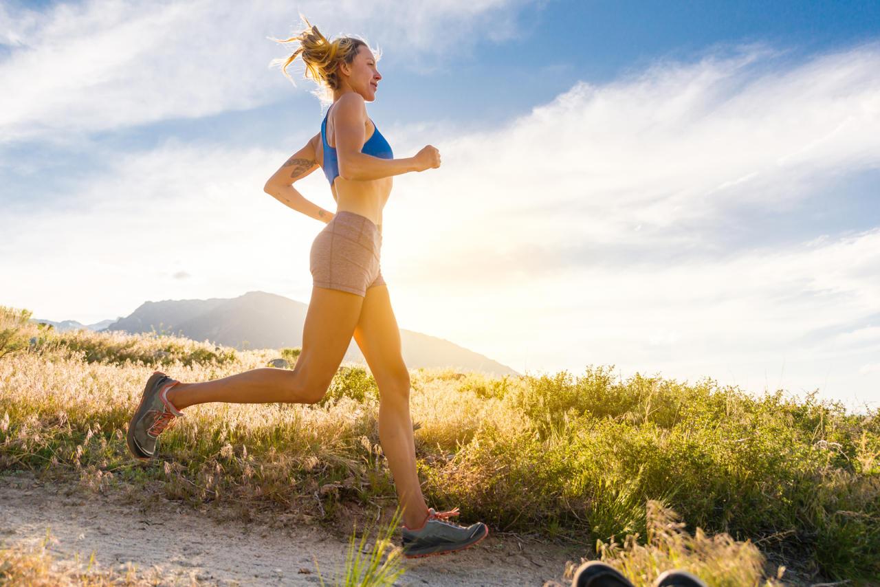 Women Runner Running At Sunset