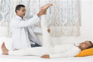 Physical Therapist Leg Exercise
