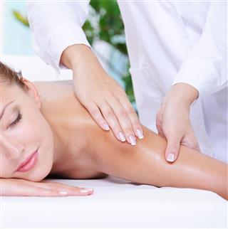 Pretty Woman Getting Massage Of Shoulder