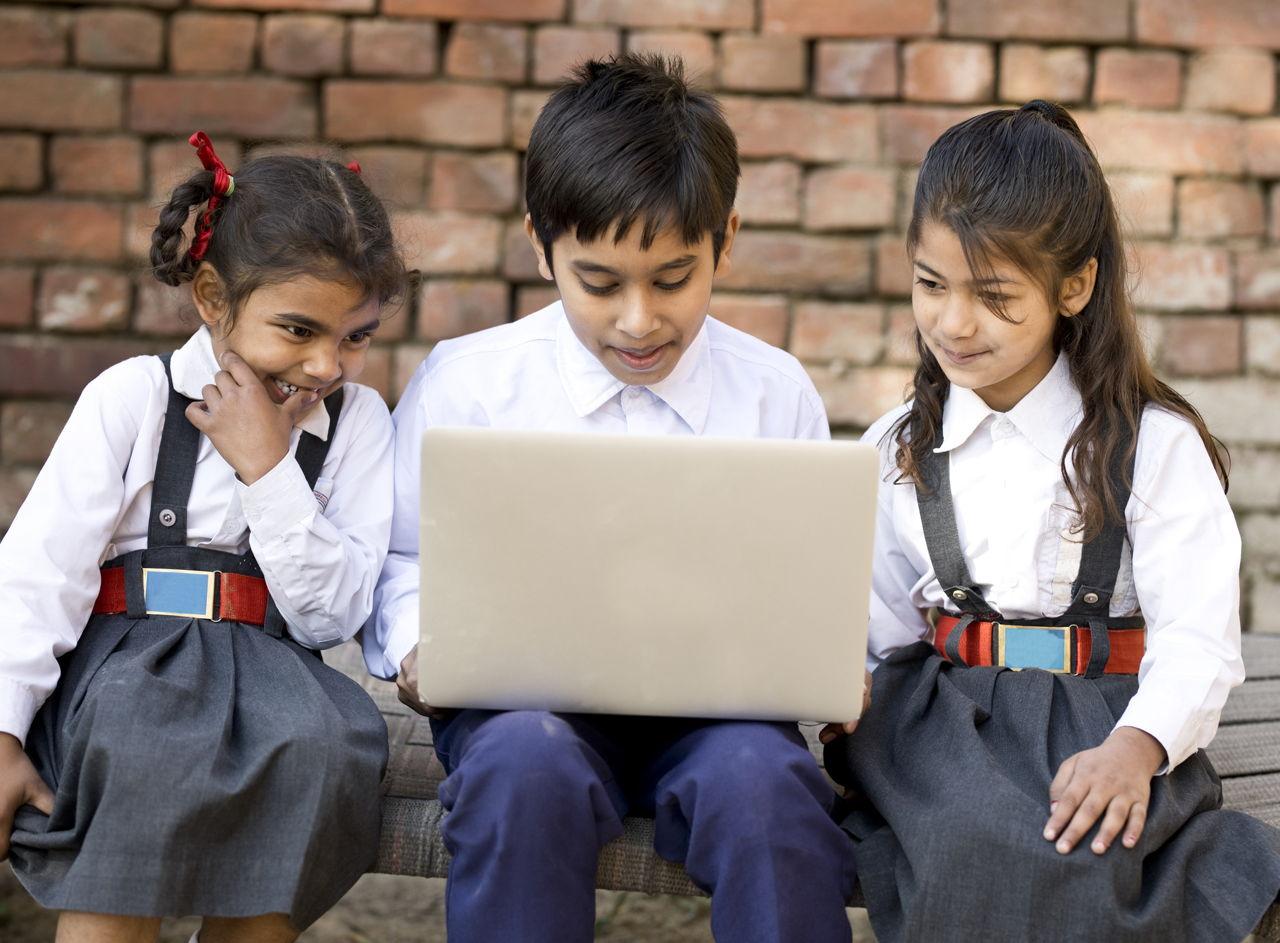 School Kids Using Laptop