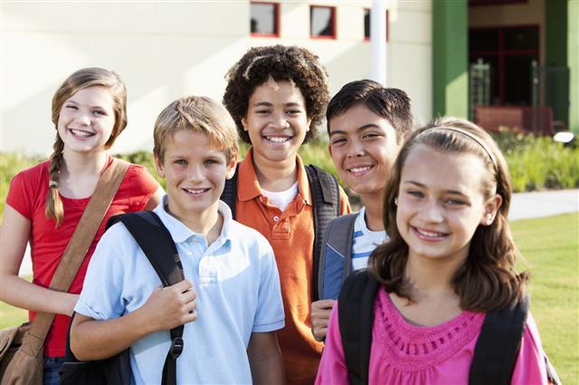 Happy Children Standing Outside School