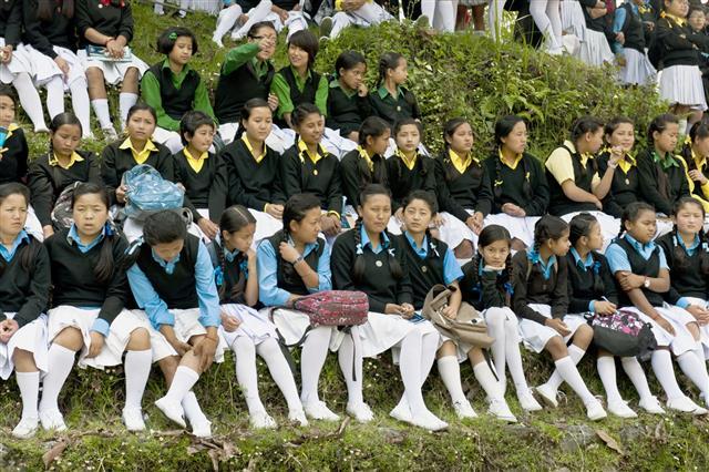 Schoolgirls In Sikkim Watching Soccer