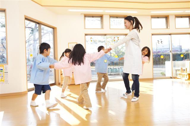 Kids And Teacher Dancing