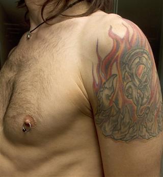 Nipple piercing and tattoo
