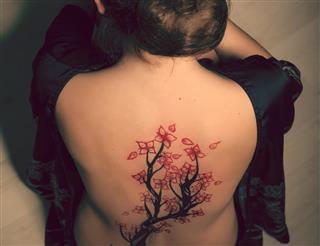 Woman back tattoo