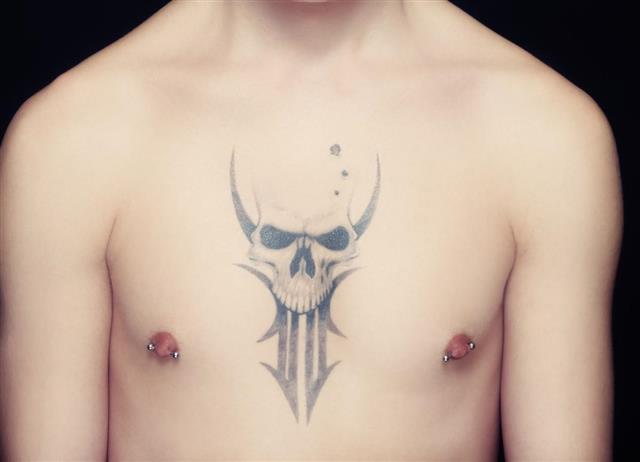Skull tattoo on chest body