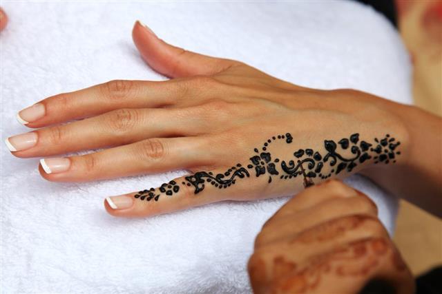 Black Henna Tattoo on hands