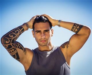 Tattooed man at sunny day