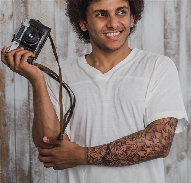 Attractive tattooed photographer