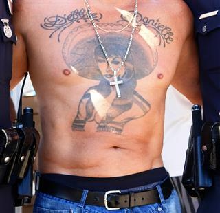 Figure Tattoo on Chest
