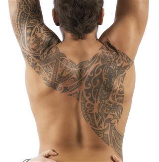 Man with polynesian tattoos