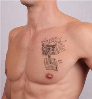 Fire wheel tattoo on chest