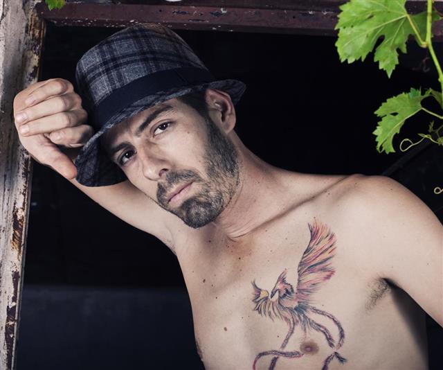 Man with bird tattoo
