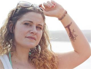Tattooed woman with sunglasses