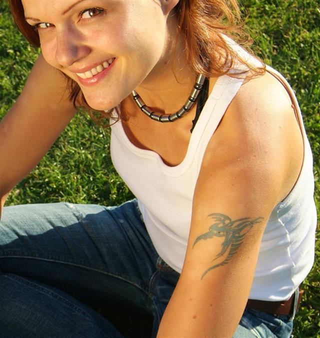 Tattooed girl in sunlight