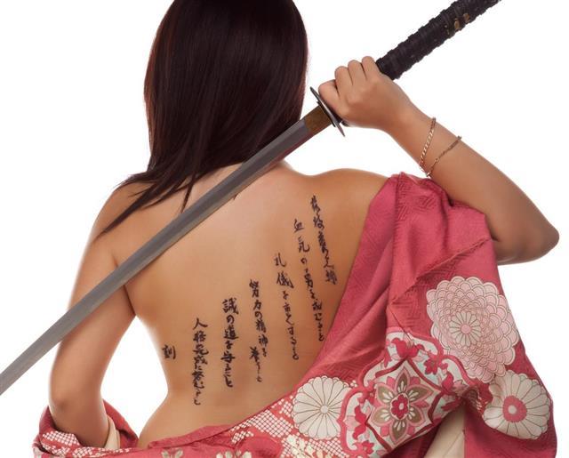 Tattoos on woman back body