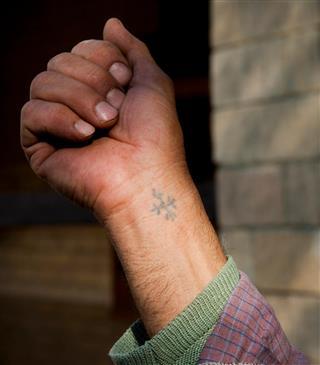 Cross tattoo on the wrist
