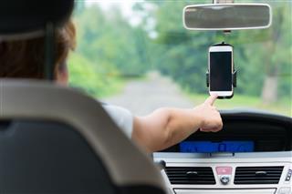 Hand Touching Screen On Smart Phone
