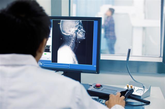 Radiologist Examining Mri Scans