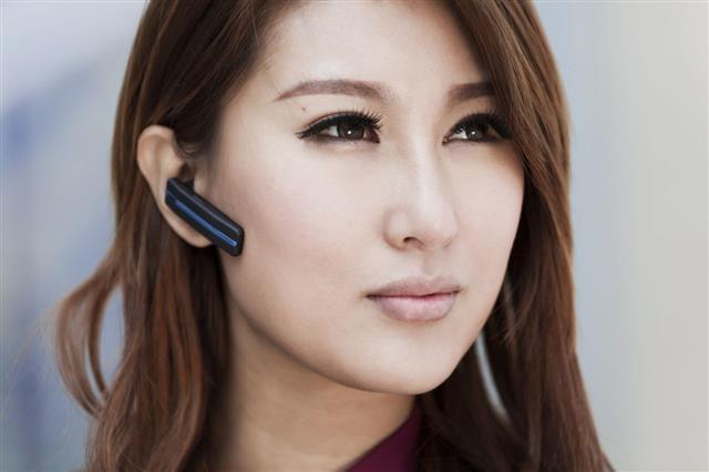 Businesswomen With Bluetooth Earphone
