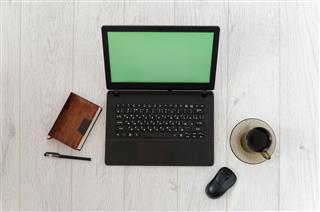 Laptop And Mug Of Coffee