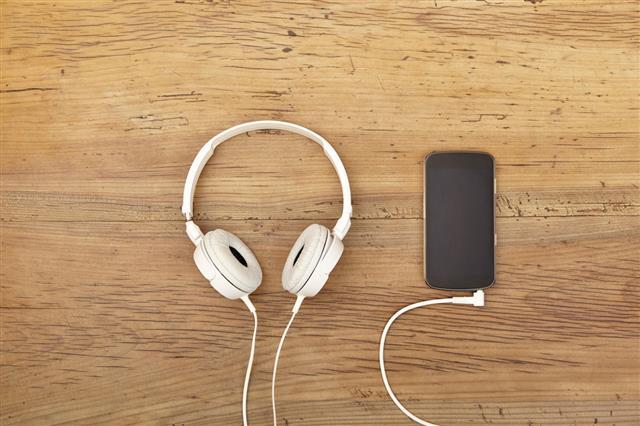 White Headphones And Smartphone