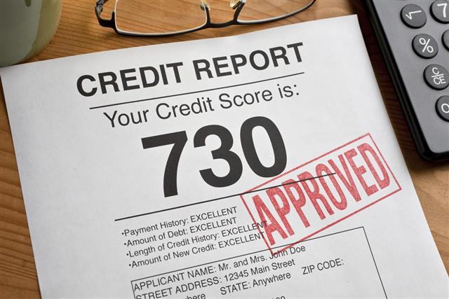 Approved Credit Score form on a desk