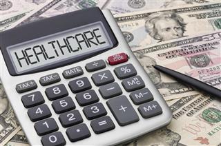 Calculator with money – Healthcare
