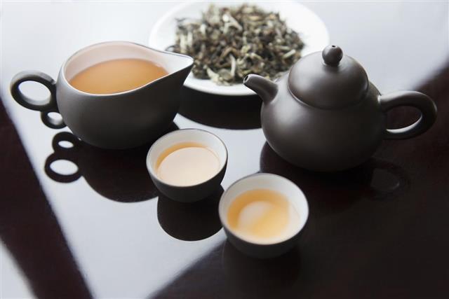 Tea Set and White Tea Leaves