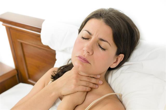 Woman having sore throat